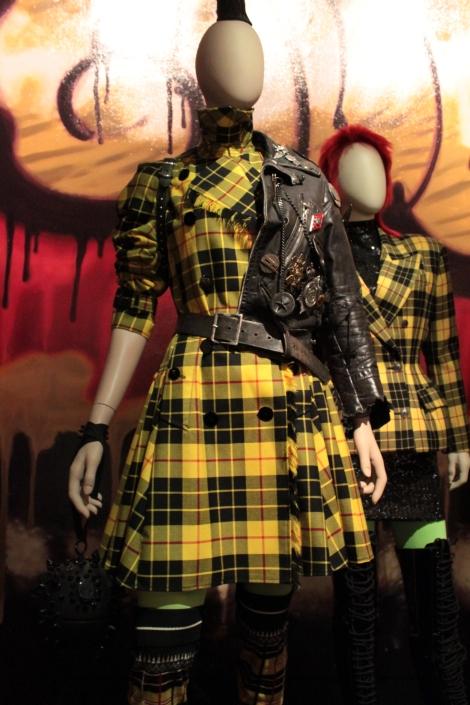 """So British"" Collection, Women prêt-à-porter, fall winter 2007-08, Tartan gabardine trench coatdress biker style demi jacket, with vintage Gaultier pins, collection of Frederique Lorca, Paris."