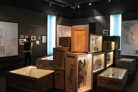 """The room with the headphones is dedicated to """"Crossing Borders"""", they decided to play with the scenario by adding a special scenography with boxes which contains artworks."""